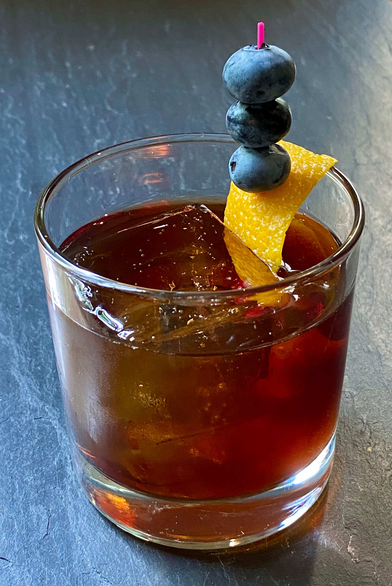 An example of the My One and Only Blue, the mixed drink (cocktail) featuring bourbon whiskey, and Pasubio Vino Amaro; photo by Martin Doudoroff