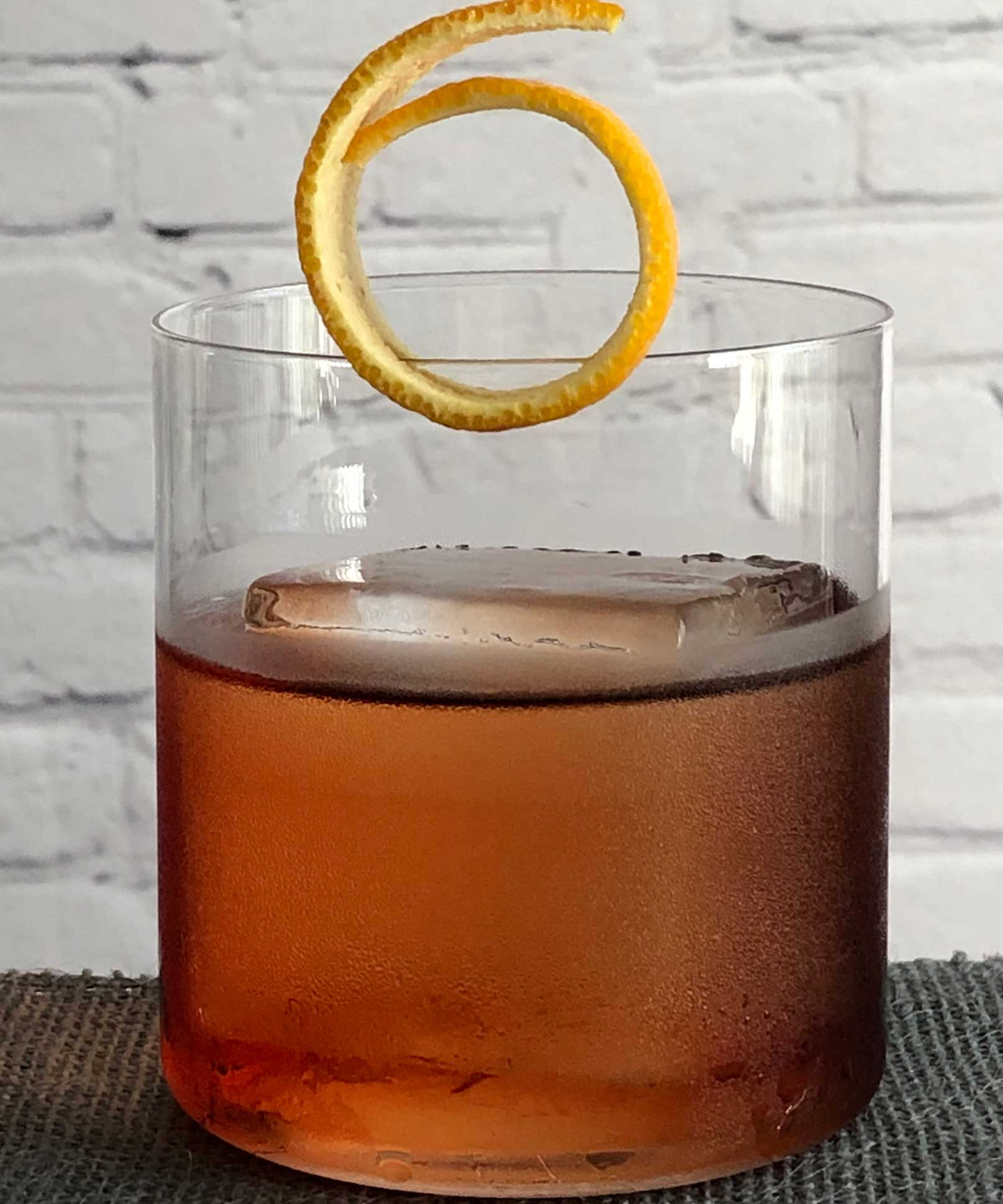 An example of the Crosstown Traffic, the mixed drink (cocktail) featuring Hayman's London Dry Gin, Cardamaro Vino Amaro, and Cocchi Americano Rosa; photo by Lee Edwards