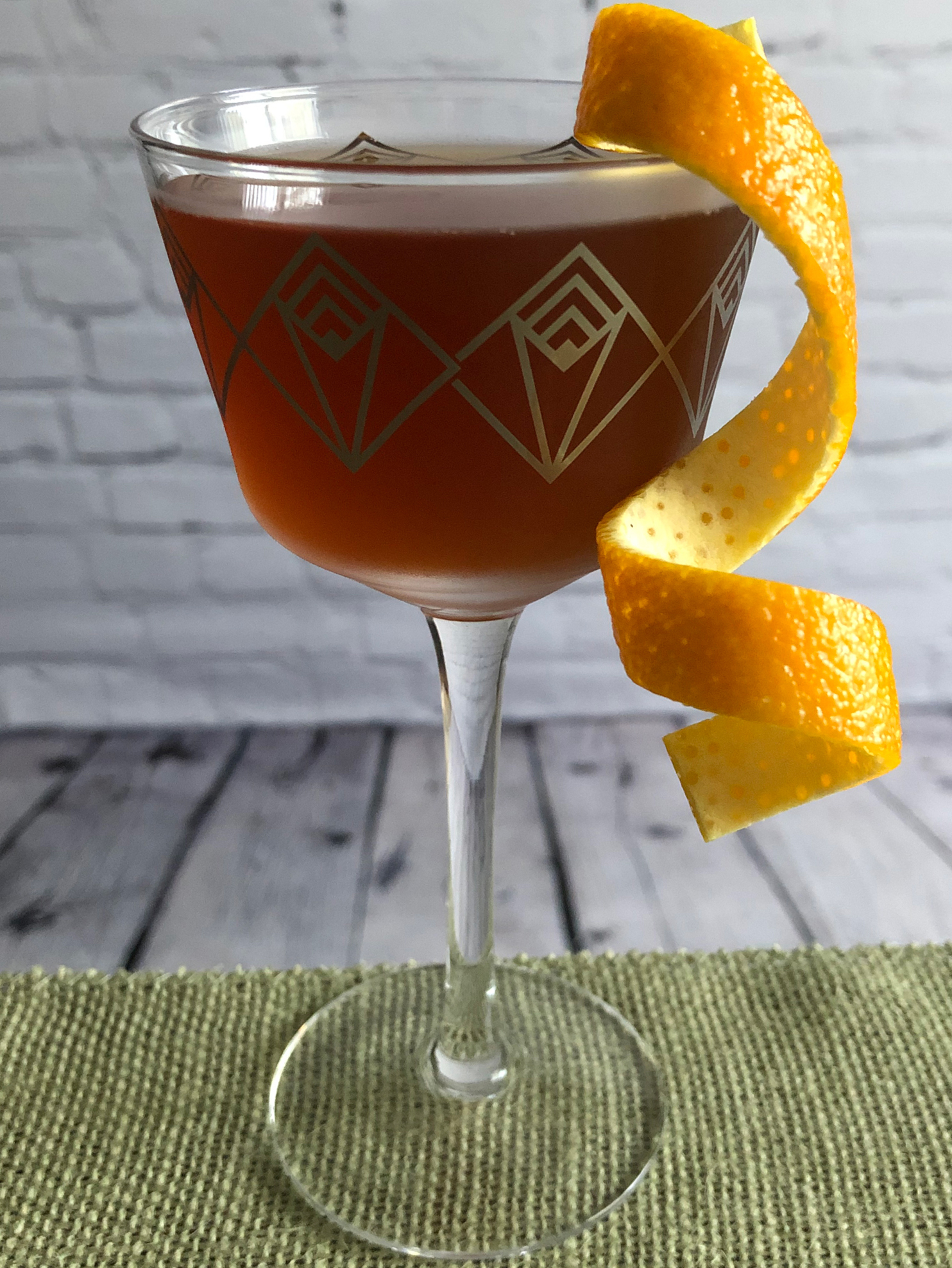 An example of the The Hammer, the mixed drink (cocktail) featuring Mattei Cap Corse Rouge Quinquina, bourbon whiskey, Kronan Swedish Punsch, and orange bitters; photo by Lee Edwards