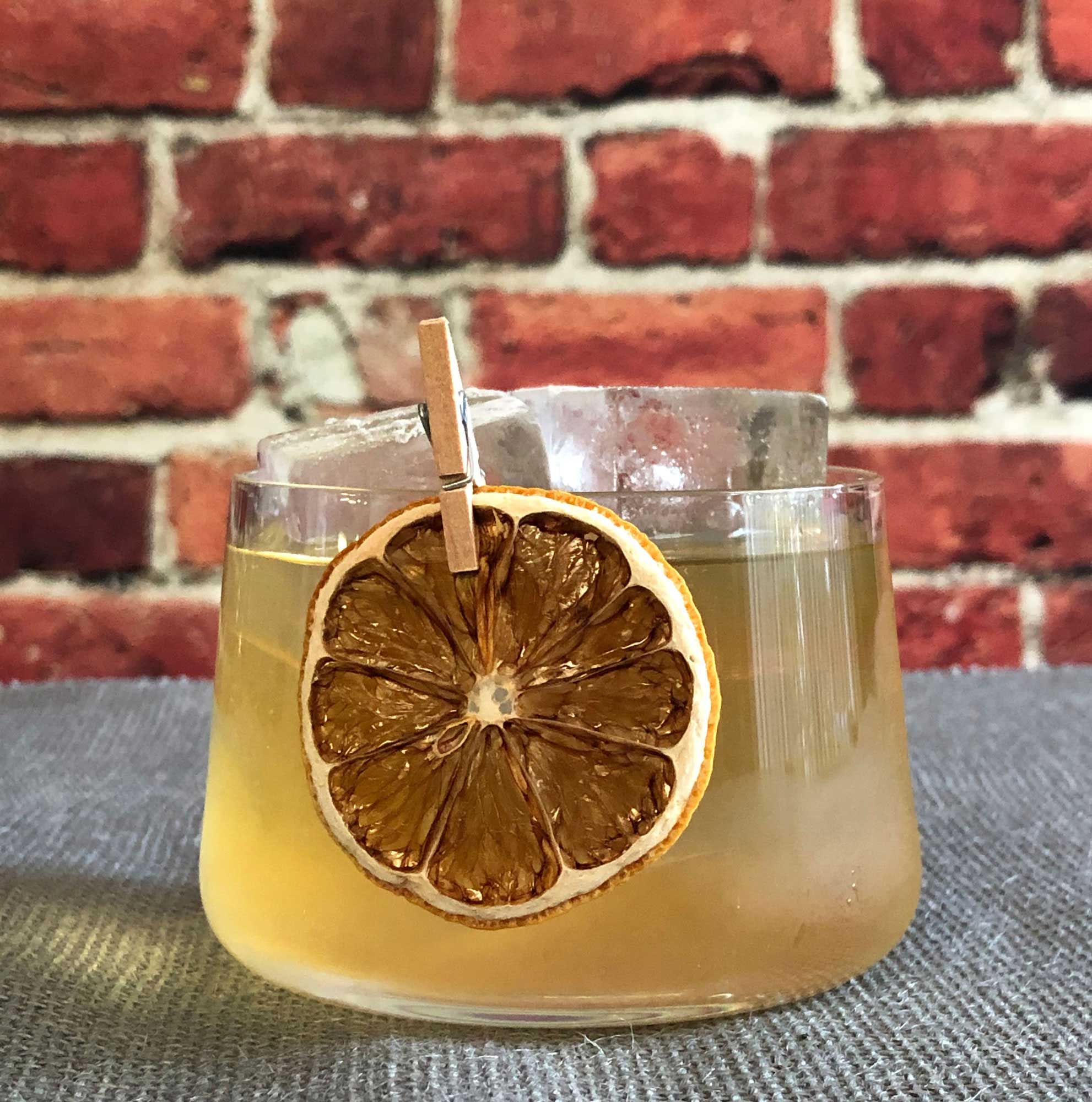 An example of the July on Royal Street, the mixed drink (cocktail) featuring Mattei Cap Corse Blanc Quinquina, Salers Gentian Apéritif, reposado tequila, Bénédictine, and lemon juice; photo by Lee Edwards