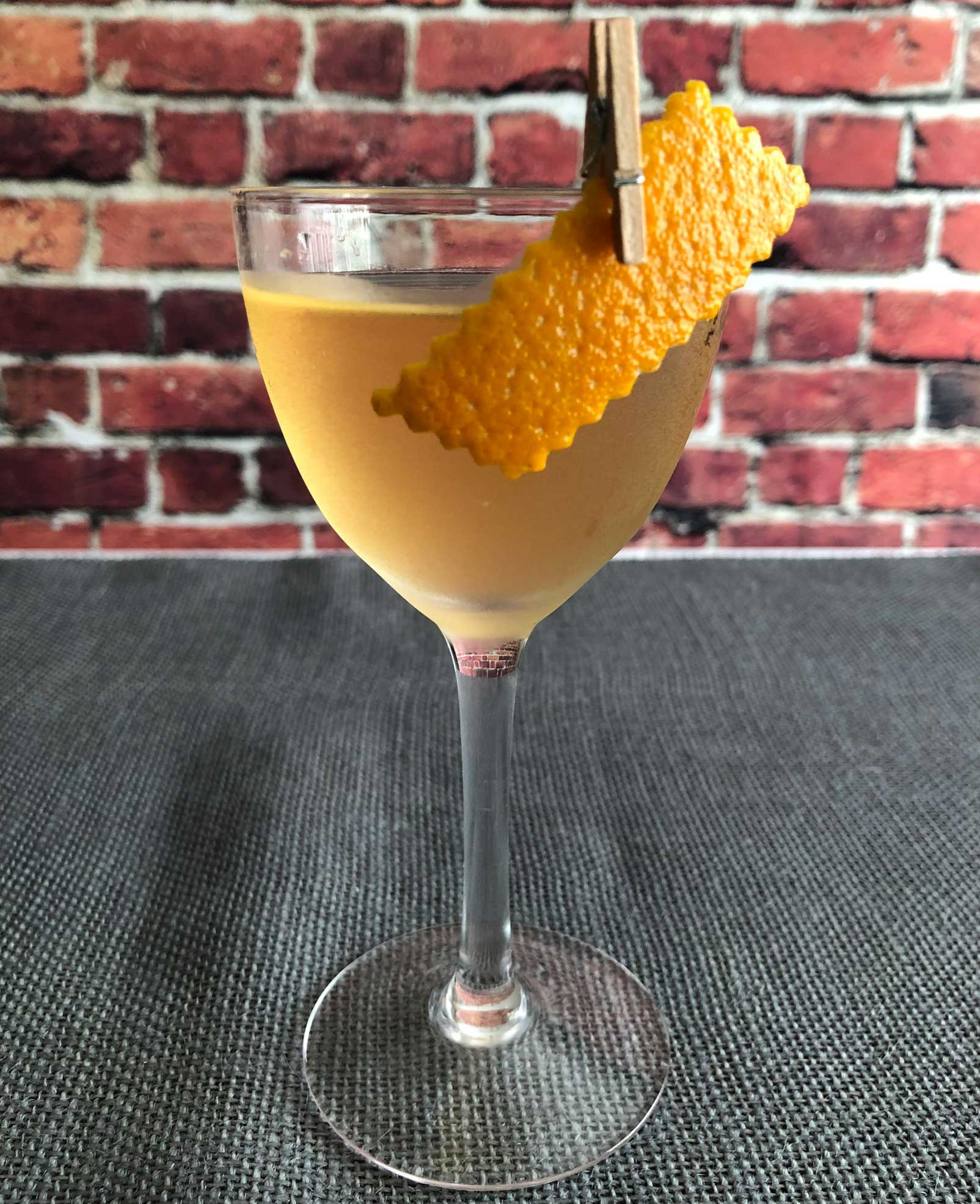 An example of the Rebirth of the Cool, the mixed drink (cocktail) featuring Mattei Cap Corse Blanc Quinquina, Purkhart Pear Williams Eau-de-Vie, and orange bitters; photo by Lee Edwards