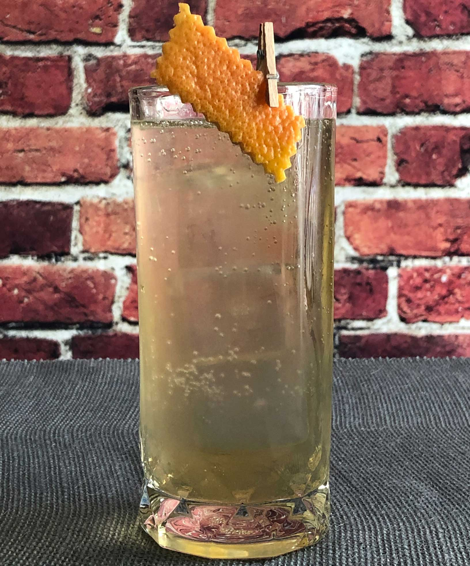 An example of the Salt of the Earth, the mixed drink (cocktail) featuring Fever Tree Indian Tonic Water, Amaro Alta Verde, and Mattei Cap Corse Blanc Quinquina; photo by Lee Edwards