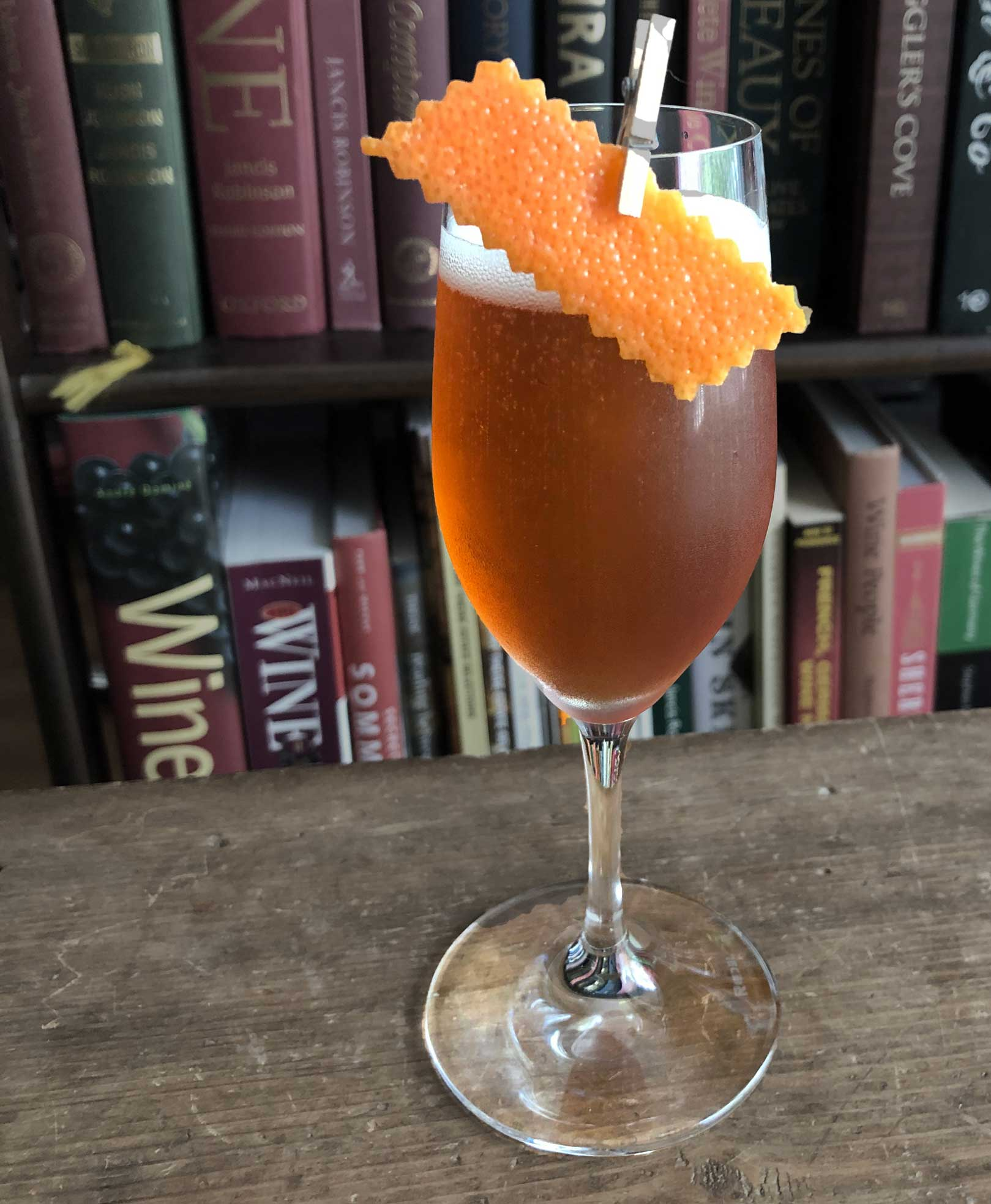 An example of the Gregorian Chant, the mixed drink (cocktail) featuring Hayman's Sloe Gin, sparkling wine, Amaro Alta Verde, and Bénédictine; photo by Lee Edwards