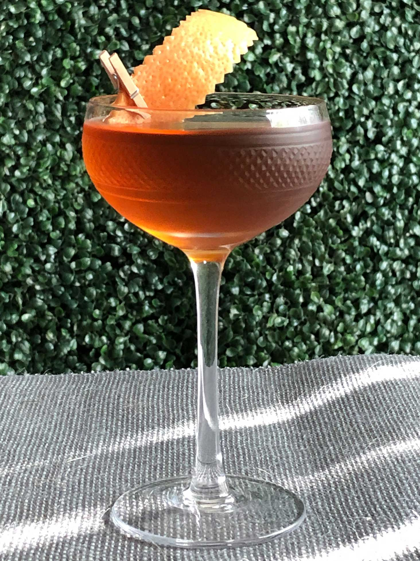An example of the Diamond in the Rough, the mixed drink (cocktail) featuring Hayman's Old Tom Gin, Bonal Gentiane-Quina, Amaro Alta Verde, and orange bitters; photo by Lee Edwards