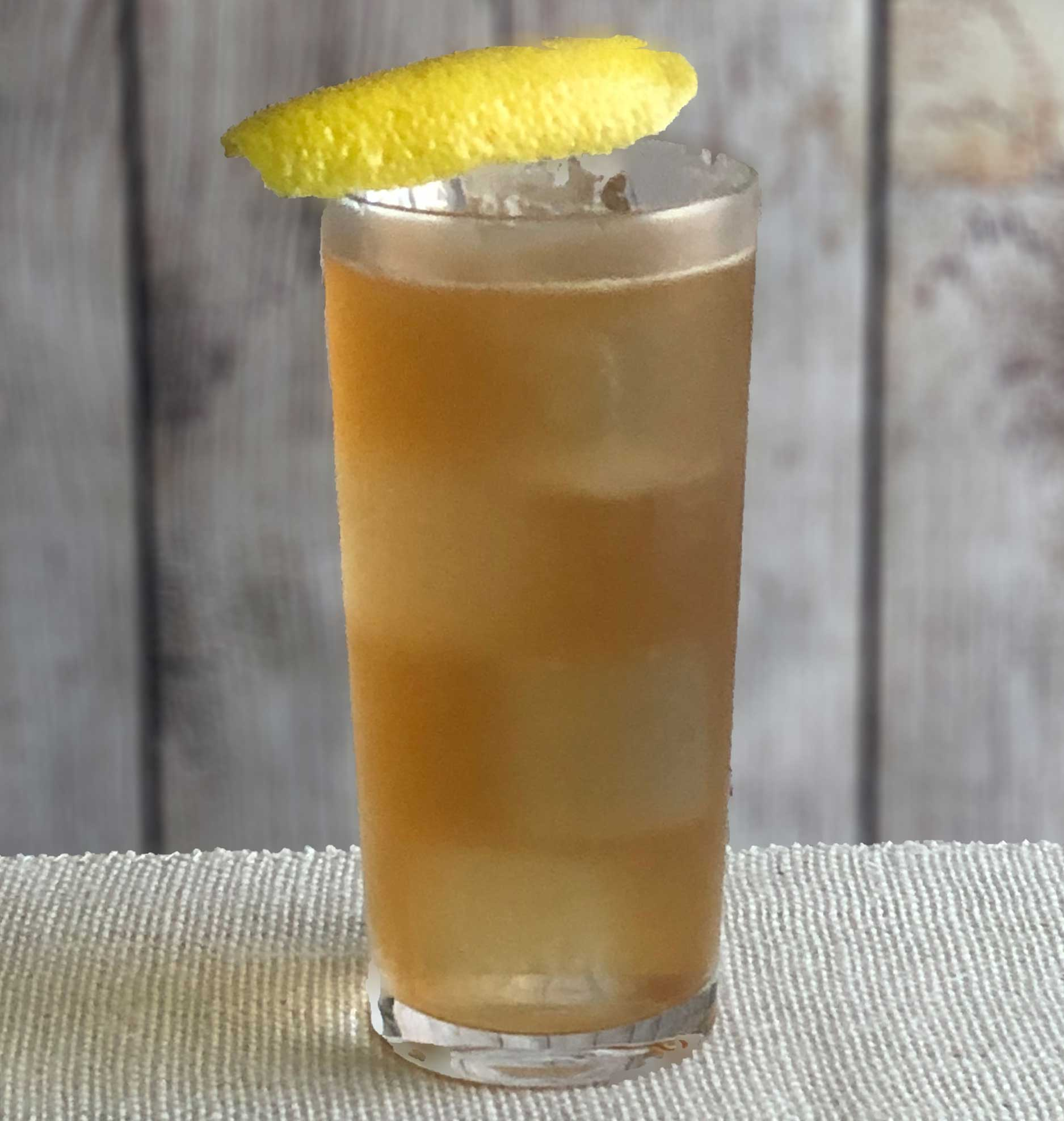 An example of the Service Station Sling, the mixed drink (sling) featuring soda water, blended scotch whisky, Mattei Cap Corse Rouge Quinquina, simple syrup, and lemon juice; photo by Lee Edwards