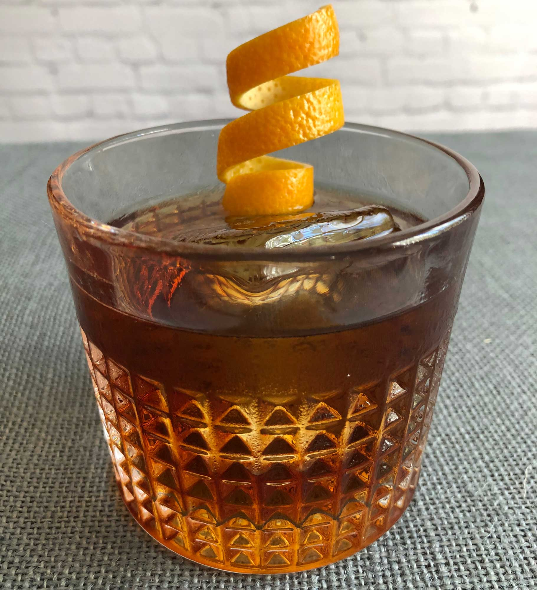 An example of the Fire on the Mountain, the mixed drink (cocktail) featuring Bonal Gentiane-Quina, single-malt scotch, and orange bitters; photo by Lee Edwards