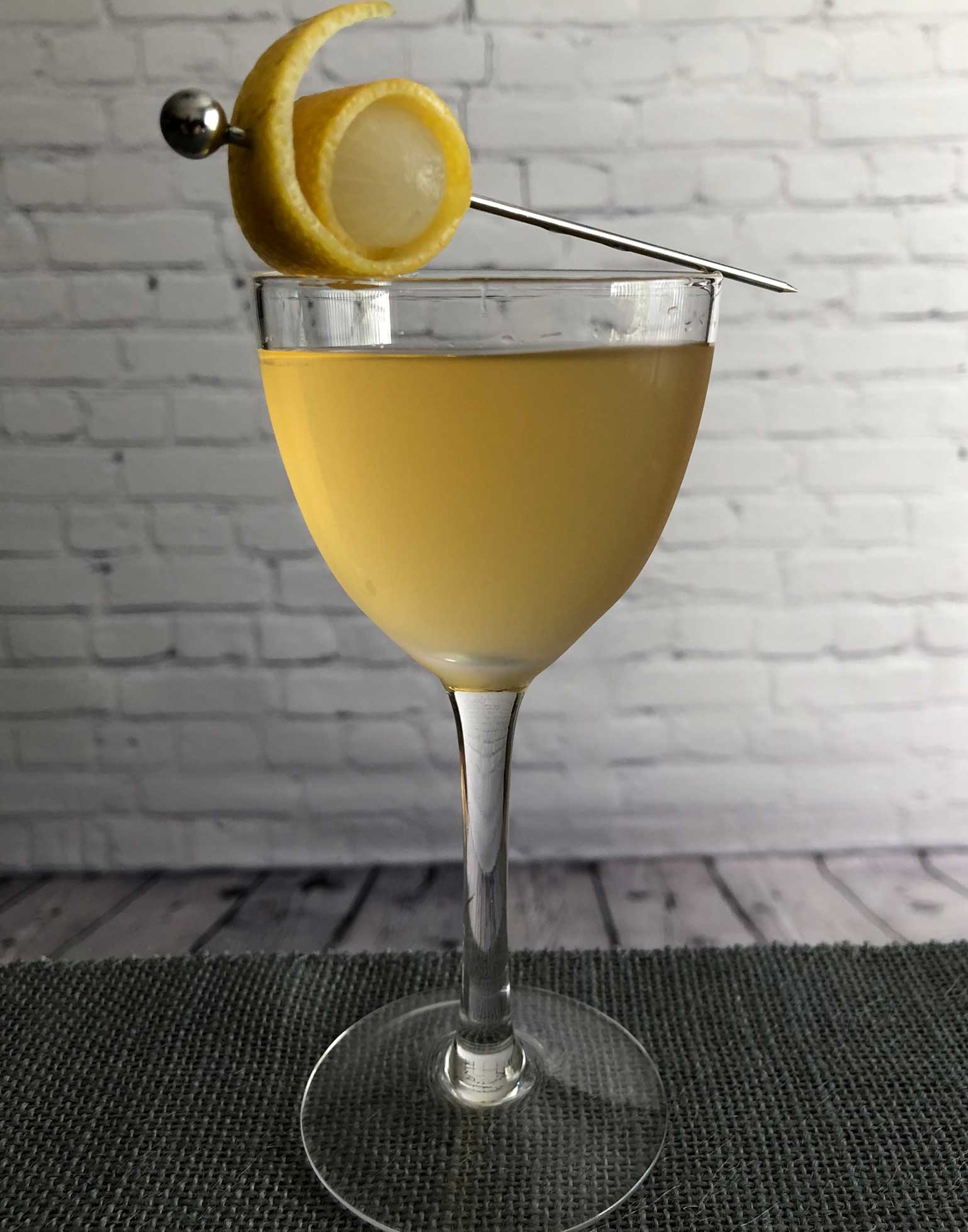 An example of the Sisters and Brothers, the mixed drink (cocktail), by Kate Perry, Seattle, featuring clairin or rhum agricole blanc, Mattei Cap Corse Blanc Quinquina, and orange bitters; photo by Lee Edwards