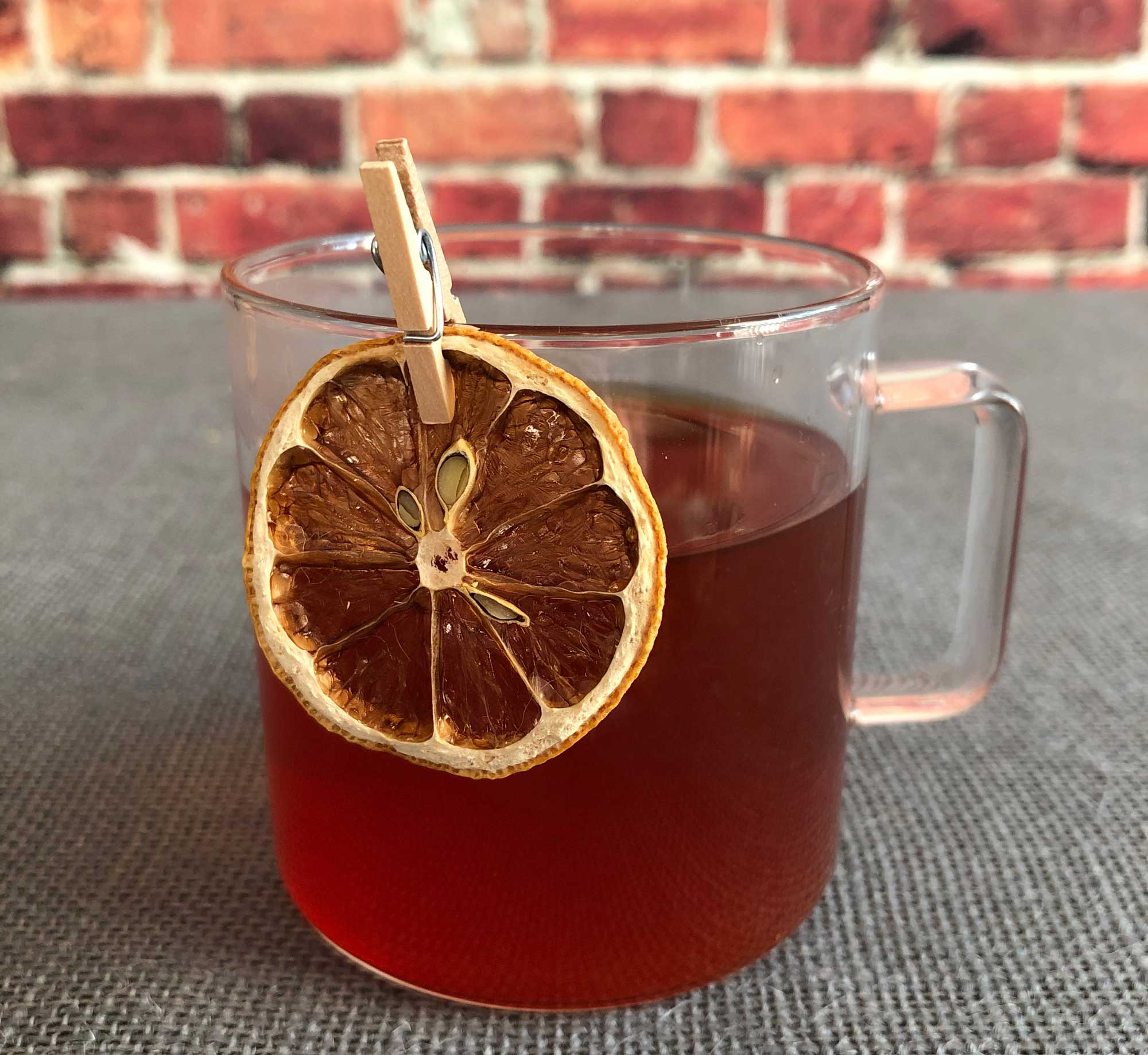 An example of the Bittered Ruby Punch, the mixed drink (punch) featuring black tea, Byrrh Grand Quinquina, Batavia Arrack van Oosten, and lemon juice; photo by Lee Edwards