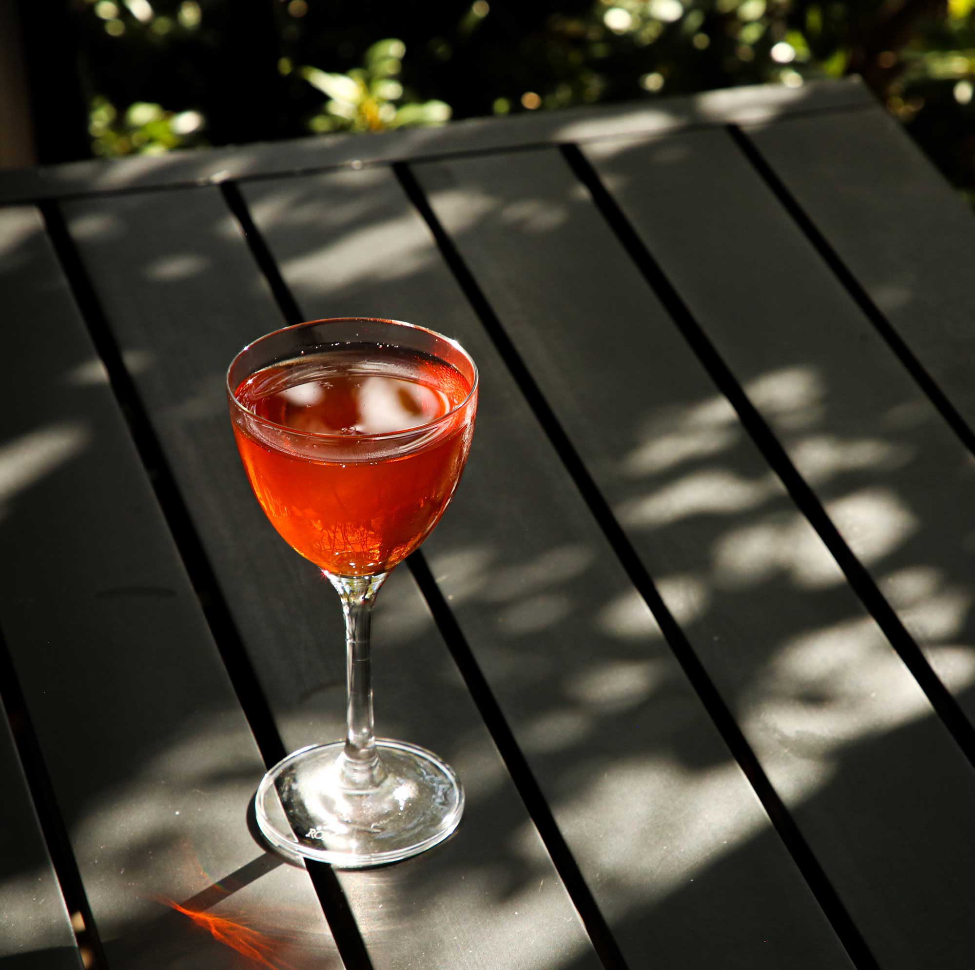 An example of the Caldera, the mixed drink (cocktail), by Liz Kelley, Cure, New Orleans, featuring reposado tequila, Aperitivo Cappelletti, and Zirbenz Stone Pine Liqueur of the Alps; photo by Liz Kelley