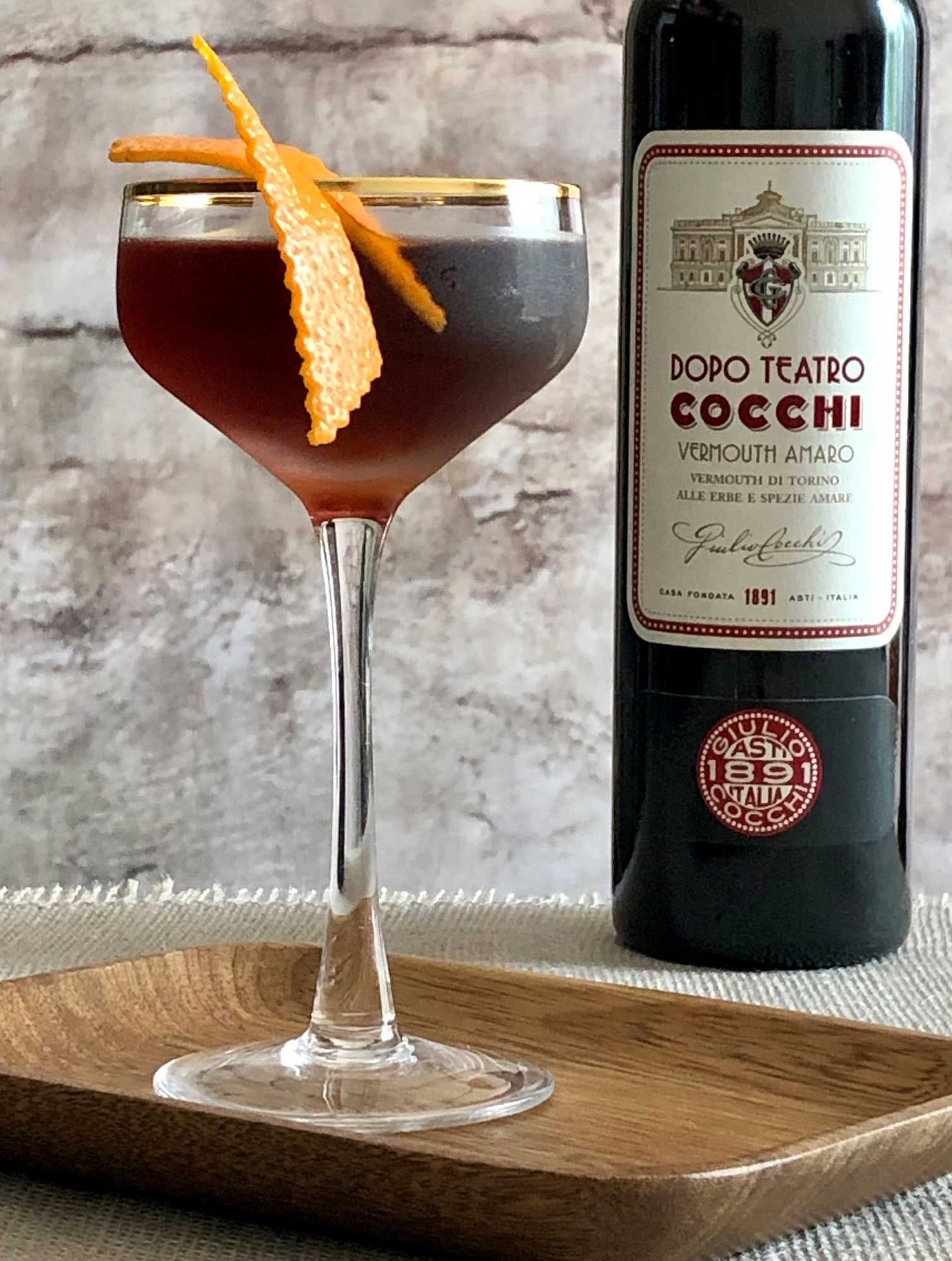 An example of the Maria Vittoria, the mixed drink (cocktail), by Sarah Goyne, Fort Smith, AR, featuring brown rum, Cocchi Dopo Teatro Vermouth Amaro, and Nux Alpina Walnut Liqueur; photo by Lee Edwards