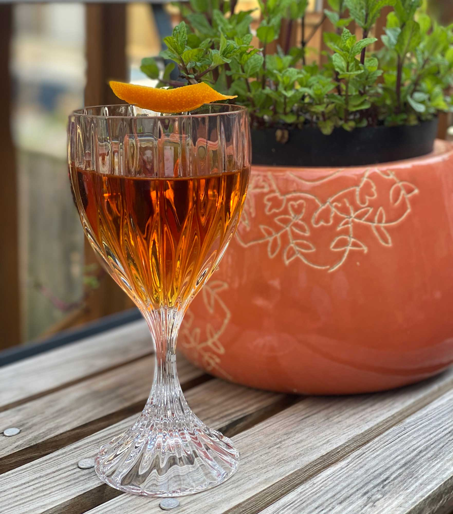 An example of the Adonis, the mixed drink (cocktail) featuring fino sherry, Dolin Rouge Vermouth de Chambéry, and orange bitters; photo by Faith Comas