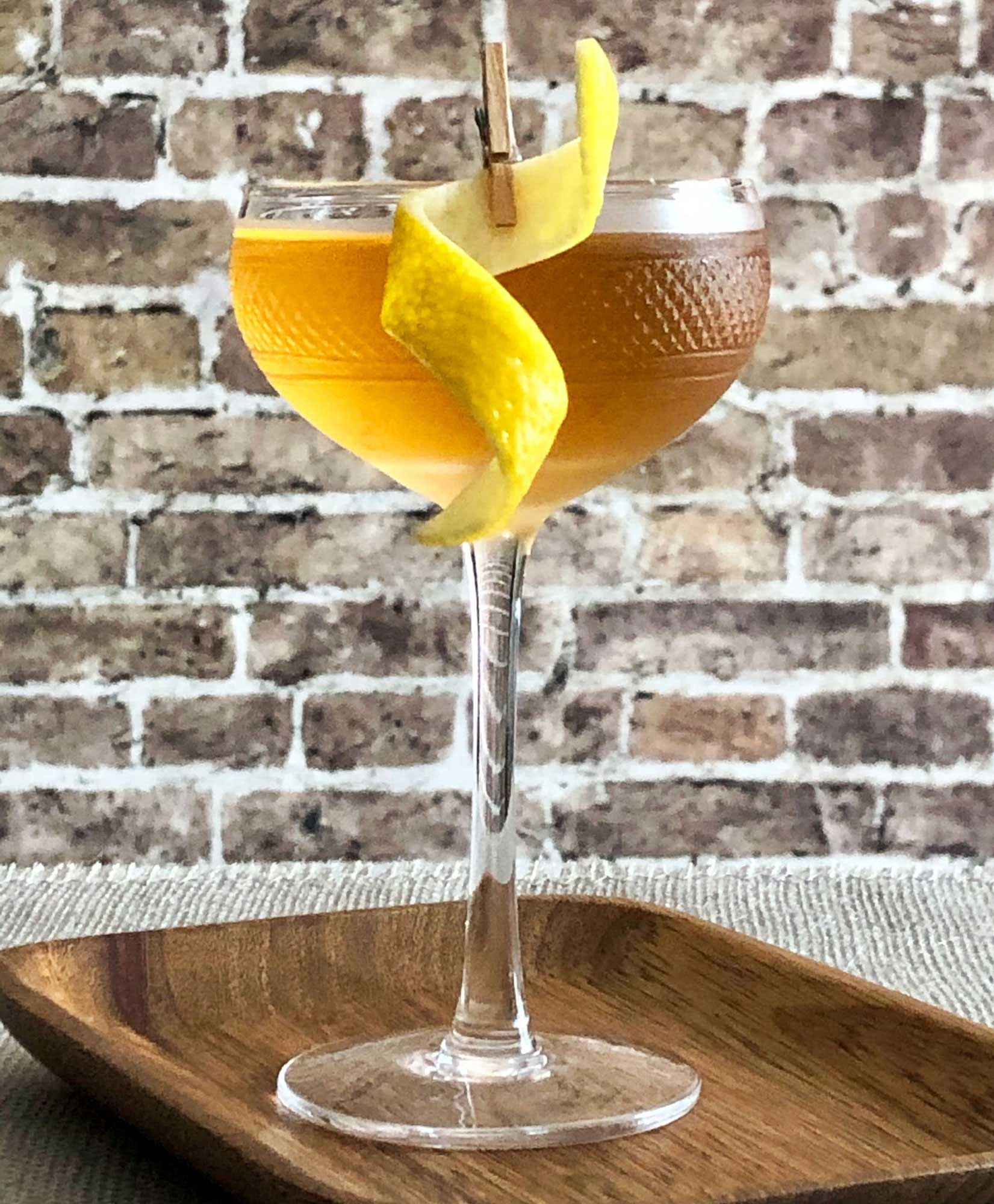 An example of the Empire, the mixed drink (cocktail), by Savoy Cocktail Book, featuring Hayman's London Dry Gin, calvados, and Rothman & Winter Orchard Apricot Liqueur; photo by Lee Edwards
