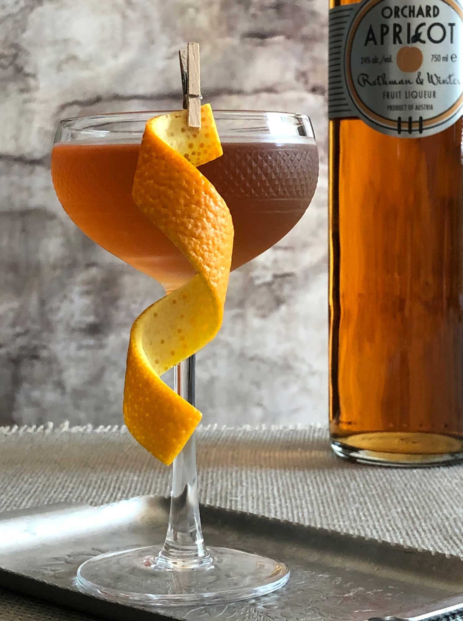 An example of the Angel Face, the mixed drink (cocktail), by Savoy Cocktail Book, featuring Hayman's London Dry Gin, calvados, and Rothman & Winter Orchard Apricot Liqueur; photo by Lee Edwards