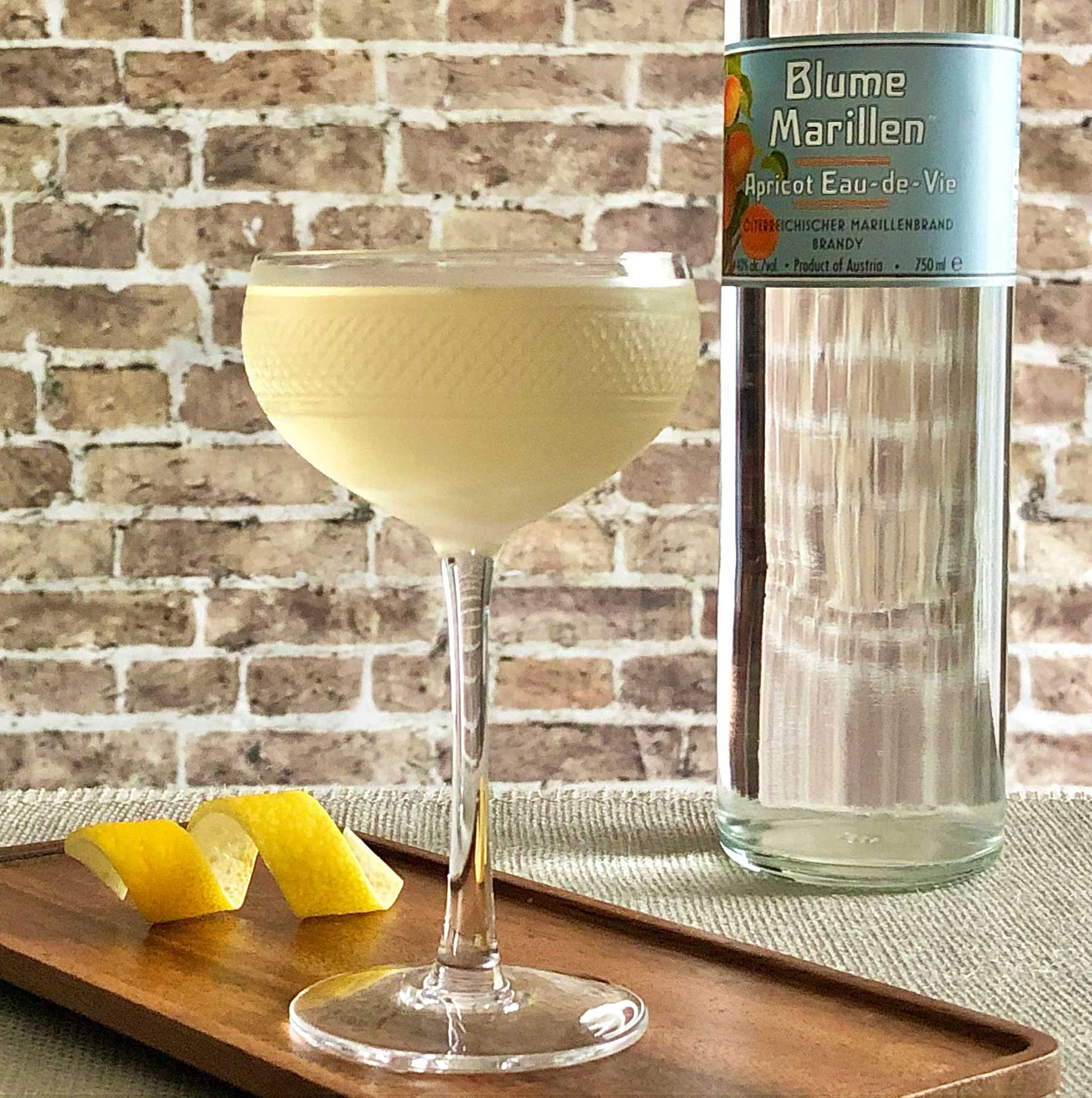 An example of the Gin Blossom, the mixed drink (cocktail), Adapted from Julie Reiner, NYC, featuring Hayman's London Dry Gin, Dolin Blanc Vermouth de Chambéry, Blume Marillen Apricot Eau-de-Vie, and orange bitters; photo by Lee Edwards