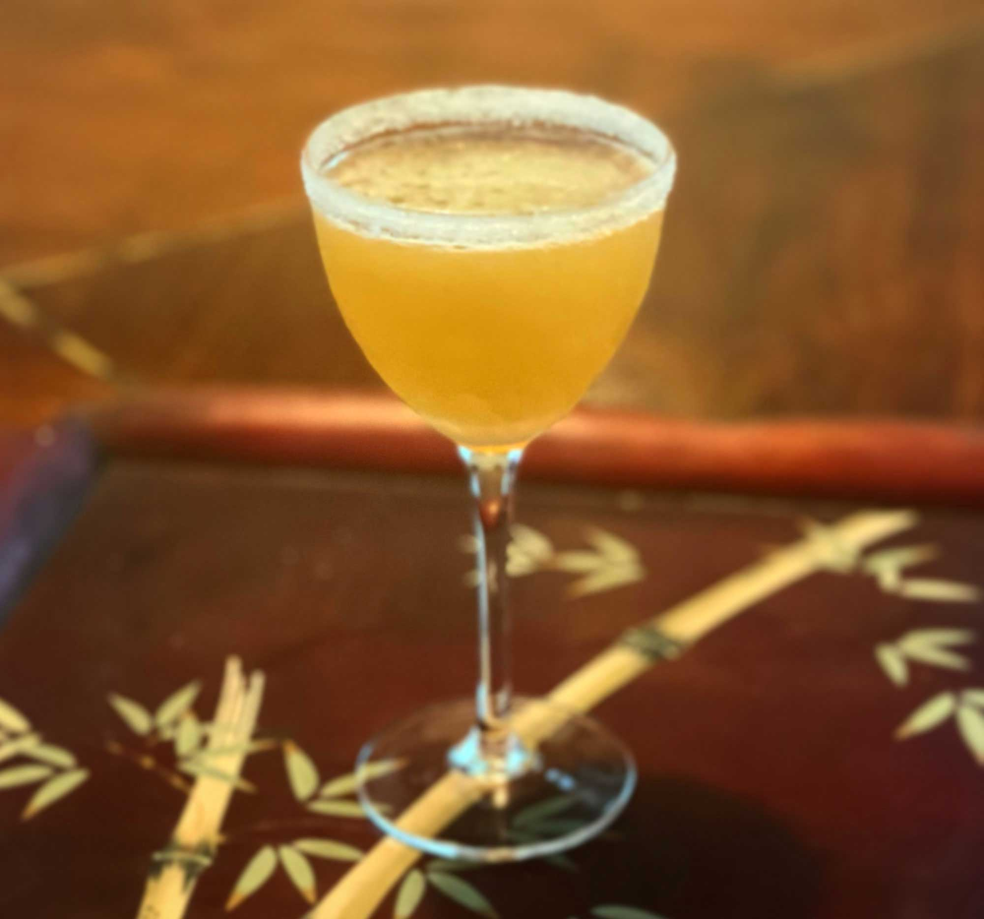 An example of the Almond Blossom Crusta, the mixed drink (crusta), by Charles Baker, 1951, featuring cognac, Hayman's London Dry Gin, lime juice, and orgeat; photo by Thierry Morpurgo