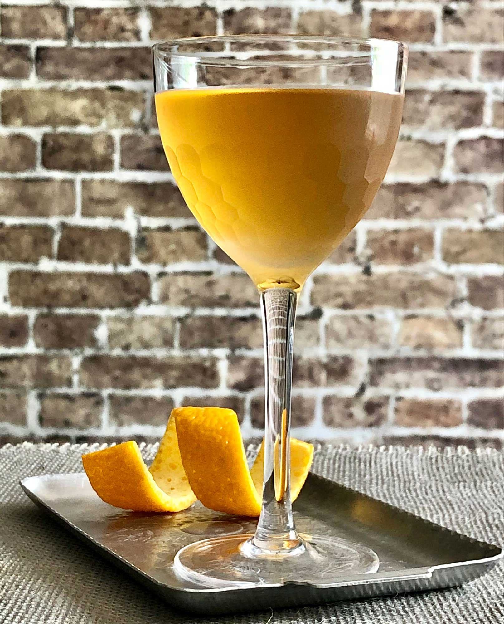 An example of the Aviators on Fire, the mixed drink (cocktail), Adapted from Chuck Kerwood, featuring cognac, Dolin Dry Vermouth de Chambéry, and Pierre Ferrand Ancient Formula Orange Curaçao; photo by Lee Edwards