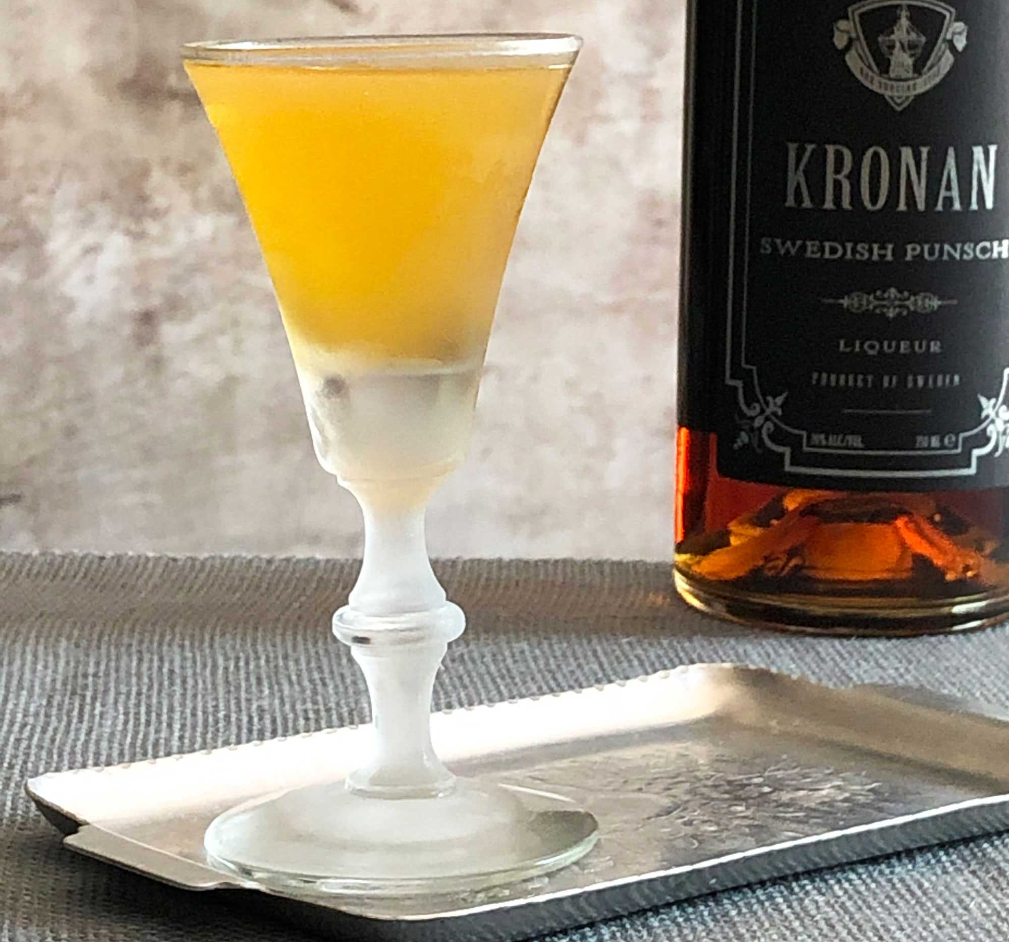An example of the Tangier Nights, the mixed drink (cocktail), by By Freddy Janowitz, featuring Kronan Swedish Punsch, cognac, and crème de menthe (white); photo by Lee Edwards