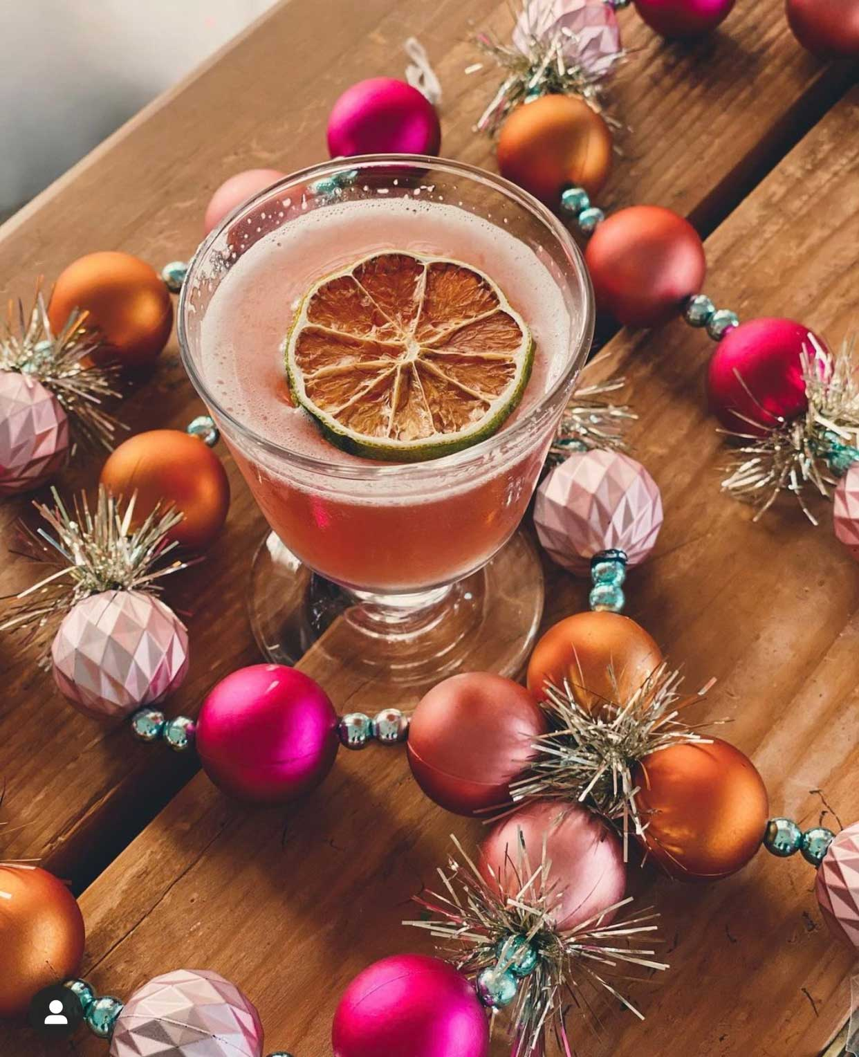 An example of the Dasher and Dancer and Daiquiri, the mixed drink (cocktail), by Rogan Howitt, Springfield MO, featuring Byrrh Grand Quinquina, white jamaican rum, orgeat, and aromatic bitters; photo by Rogan Howitt